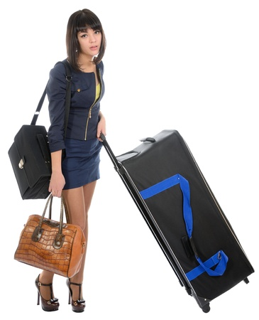 The girl with the big black suitcase on a white background