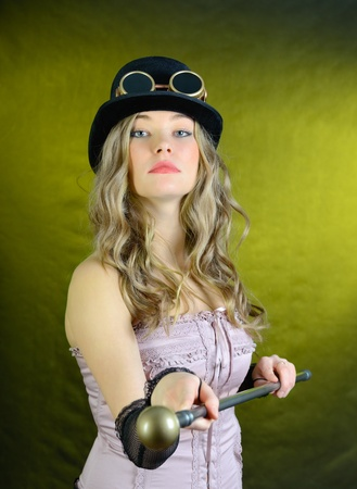 Steampunk female with a cane, top hat and goggles. Stock Photo - 17751662