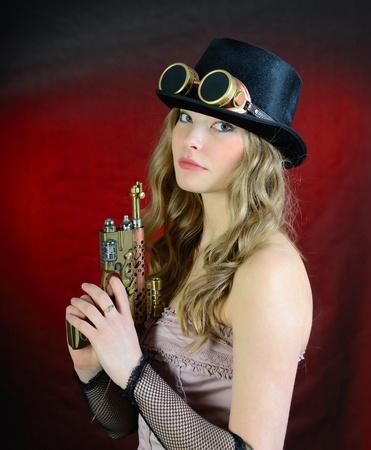 steampunk goggles: Steampunk Mujer Con Pistola, sombrero de copa y gafas