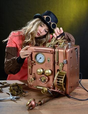 Steam punk girl repairing Phone. Telephone - Handhome made model. Stock Photo