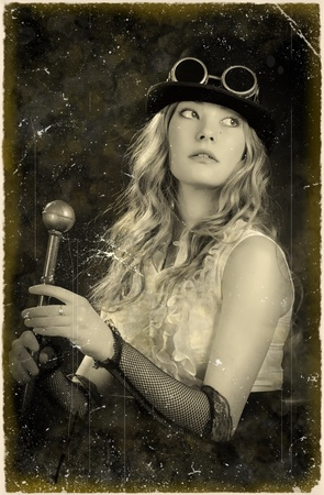 Retro styled photography of a posing steampunk girl . photo