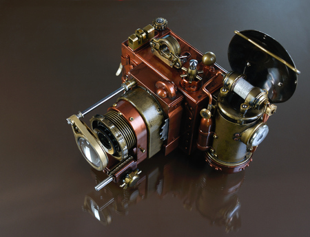 Camera steampunk on a red background  Style Steampunk