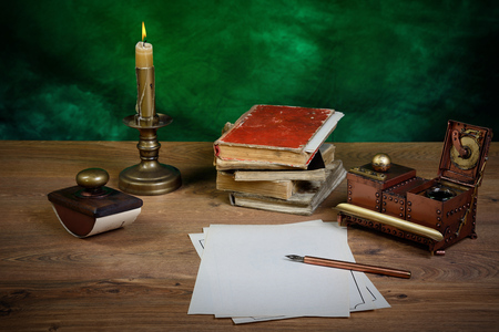 blotter: paper, ink pen, inkstand and paperweight on  table.