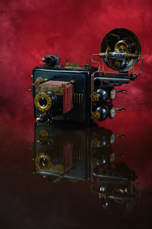 steampunk: Camera steampunk on a red background. Style Steampunk. Stock Photo