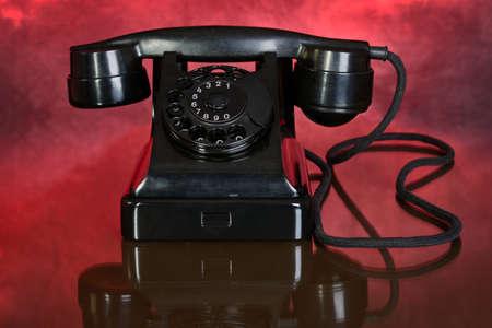 Black phone on red background Stockfoto