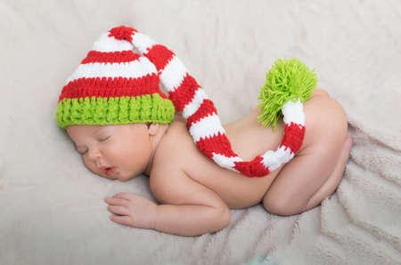 swaddling: sleeping newborn baby in a wrap