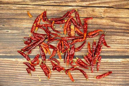 Red dried chili ingredients on wood grain desktop