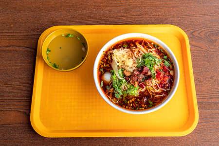 Red soup beef noodles in a big bowl Banco de Imagens