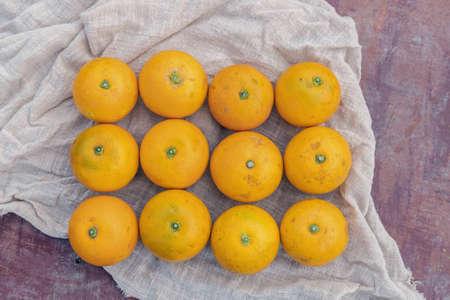 Fresh fruit crystal sugar oranges neatly placed on the cloth Banco de Imagens