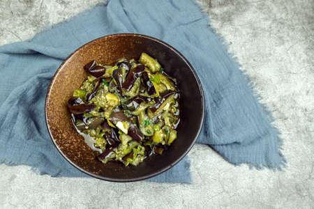 Fried Eggplant with Vegetarian Vegetables in a Dark Large Porcelain Bowl