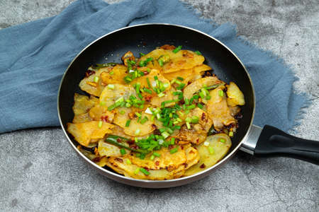 Home-cooked potato chips in a pan