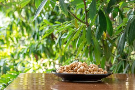 Peanuts in a plate Фото со стока