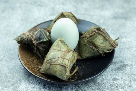 Salted duck eggs and zongzi on the plate Stockfoto