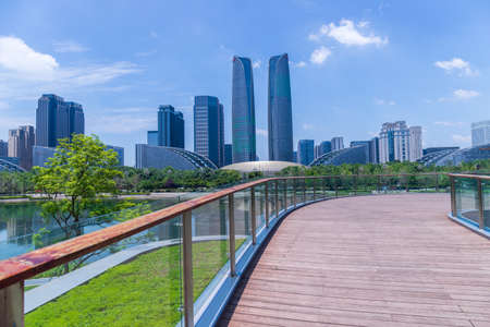 Chengdu Jiaozi Park boardwalk and financial city buildings Editorial
