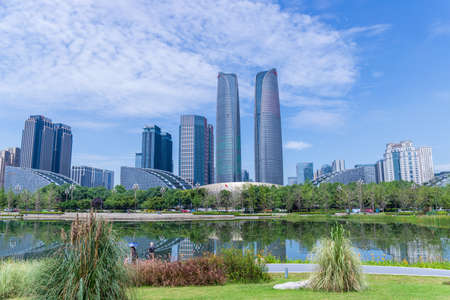 Lake View of Jiaozi Park, Chengdu, Sichuan and Architectural Landscape of Financial City Editorial
