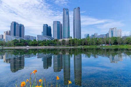 Chengdu Jiaozi Park Lake View and Financial City Architecture Banco de Imagens - 151081521