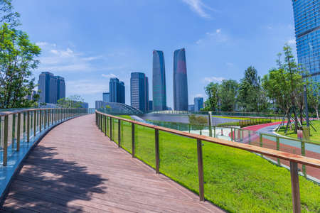 The tall buildings of Chengdu Financial City and the green landscape of Jiaozi Park