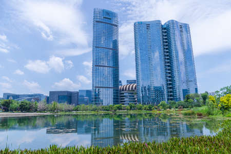 Chengdu Jiaozi Park Lake View and Financial City Architecture Scenery Editorial