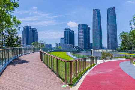 High-rise buildings in Chengdu Financial City and sports track in Jiaozi Park