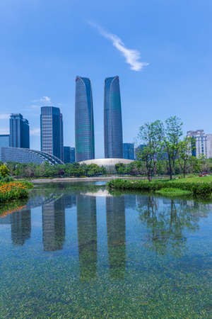 Scenery of Chengdu Financial City buildings and lake view of Jiaozi Park