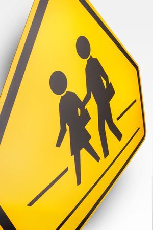 Children Crossing Road Sign on white background photo