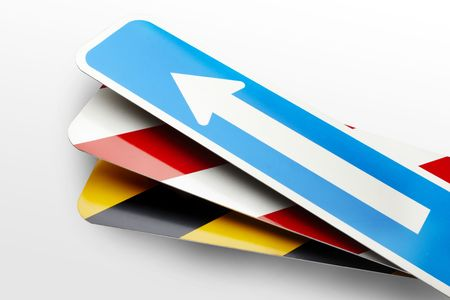 Arrow and Stripe Road signs on a white background photo