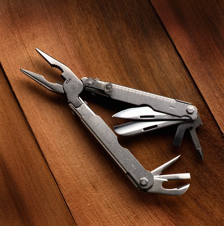 A multiple purpose tool on wooden background photo