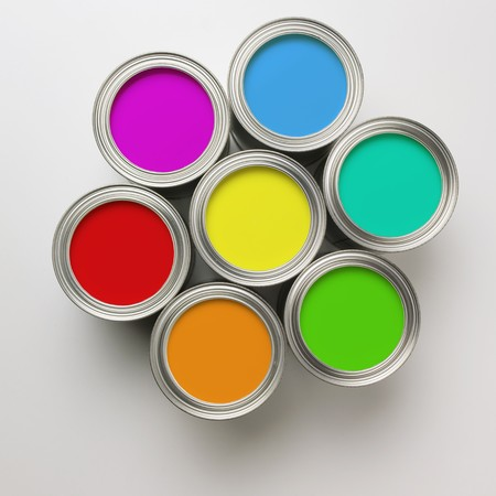 arranged: A group of colorful paint cans arranged in a circle Stock Photo