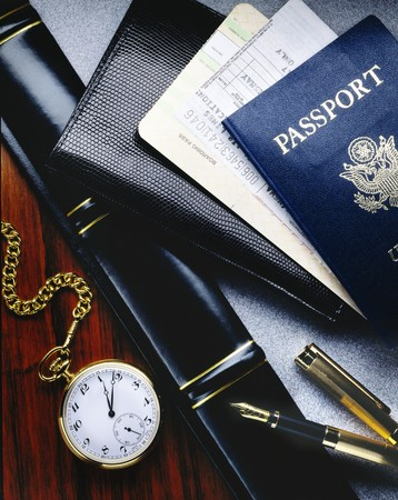 Airline tickets with passport on a desk photo