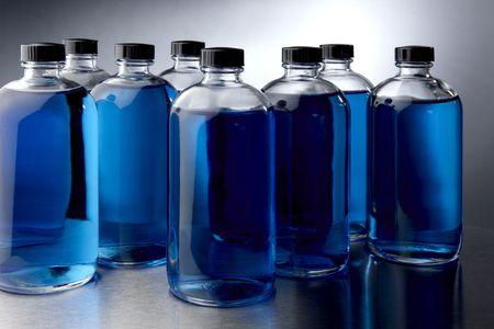 glass bottles filled with blue liquids Stock fotó