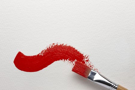 artist's canvas: An artists brush leaves a red brush stroke on canvas