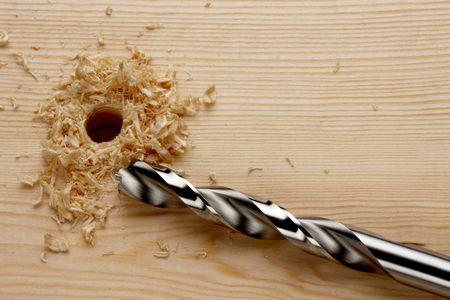 drill bit: Newly drilled hole with saw dust Stock Photo