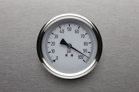 Pressure gauge shot on stainless steel background Reklamní fotografie