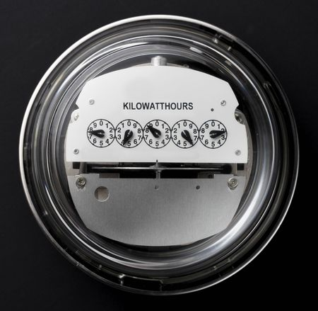 Electric meter shot straight on with dark background Imagens