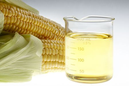 Beaker of of ethanol and ears of corn shot on lightbox