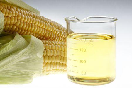 Vaso de etanol y orejas de maíz se disparó en caja luminosa Foto de archivo - 5312132