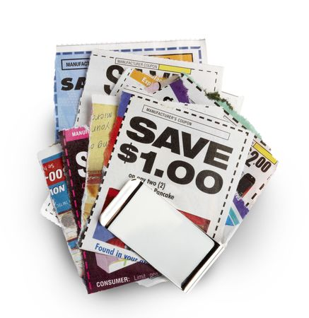 Besparingen coupons bij elkaar gehouden door zilveren geld clip Stockfoto