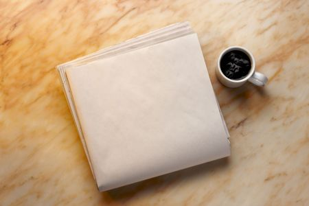 broadsheet: Blank newspaper and cup of coffee on marble surface. Add your own copy. Stock Photo