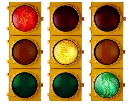 red traffic light: Traffic light repeated three times, each with a different light on Stock Photo