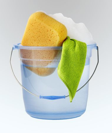 soap suds: Bucket of water, soap suds, sponge and towel