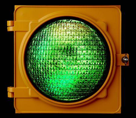 Close up of illuminated green traffic light lens