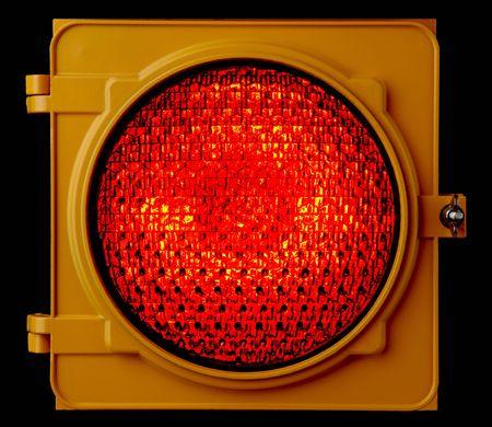 red traffic light: Close up of illuminated red traffic light lens Stock Photo