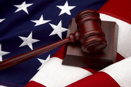 Close up shot of wooden gavel shot on American flag