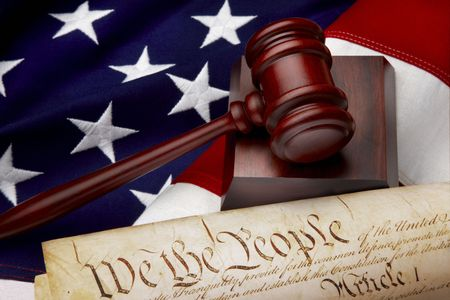 judges: Gavel, and U.S. Constitution shot on American flag Stock Photo