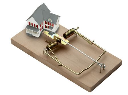 mouse trap: model of a house shot in mouse trap Stock Photo