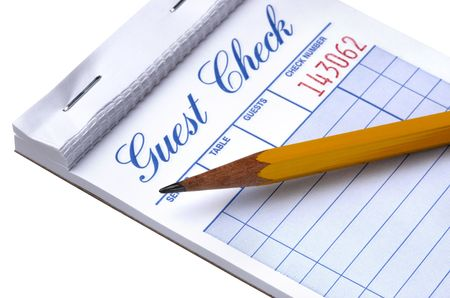 restuarant: Pad of blank guest checks with pencil shot on white background