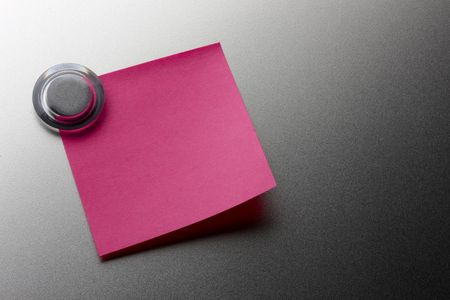 pin board: Blank pink stickie note tacked onto metal surface with magnet