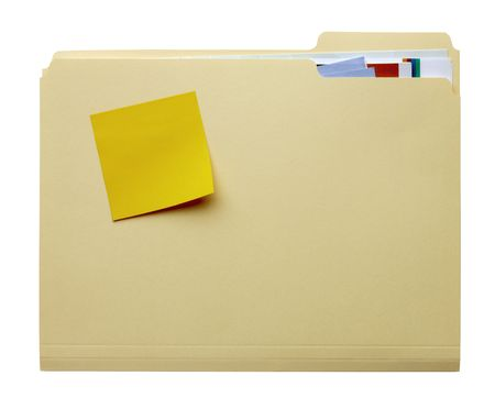 manila: manila folder filled with paperwork and blank yellow stickie tacked to outside of folder