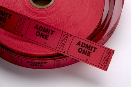 Close up shot of a roll of red Admit One tickets shot on white background with soft shadow photo