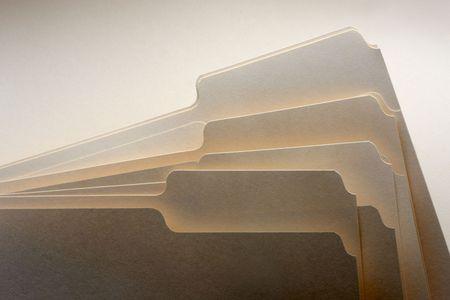 dramatically: Close up of several dramatically shot manilla folders